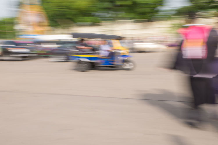 Blurred motion of people on street
