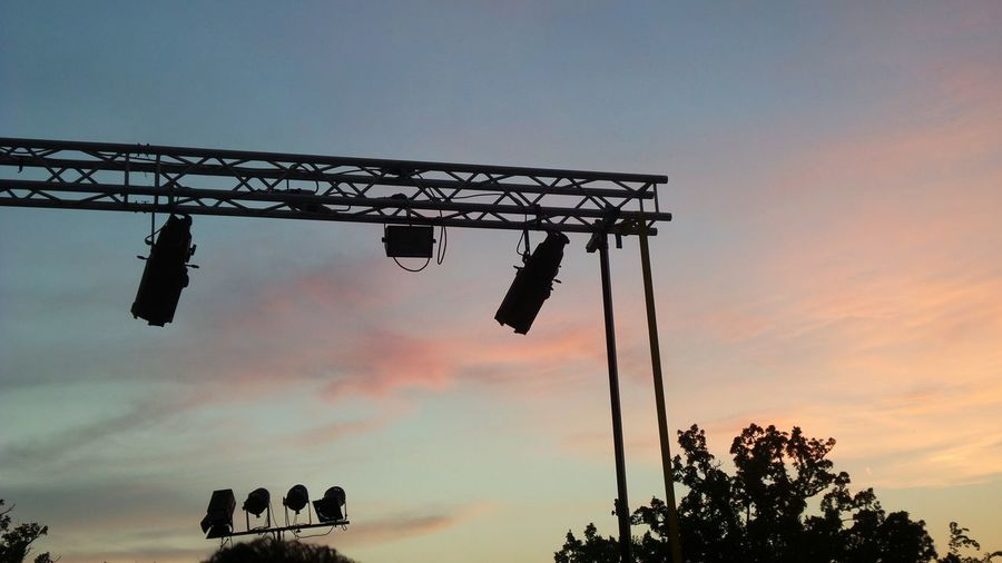 Low Angle View Of Silhouette Stage Lights Against Sky