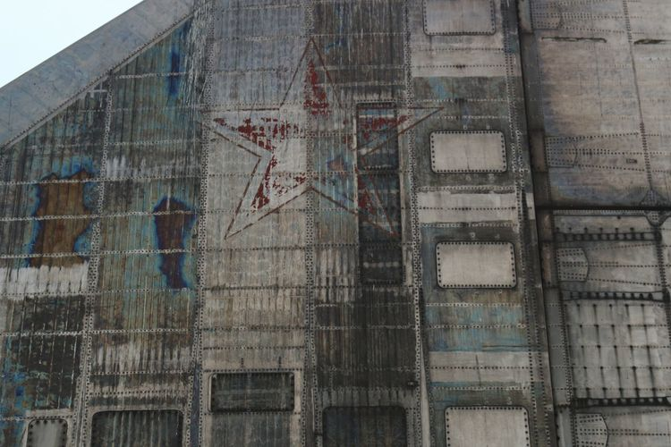 Airplane Parts Airplane Trails Airplane Soviet Soviet Era Star Star Sign Sign Star Shape Red Star Soviet Star Backgrounds Full Frame Close-up Architecture Deterioration Rough Damaged Abandoned Rusty Obsolete Weathered Bad Condition Textured  Pixelated