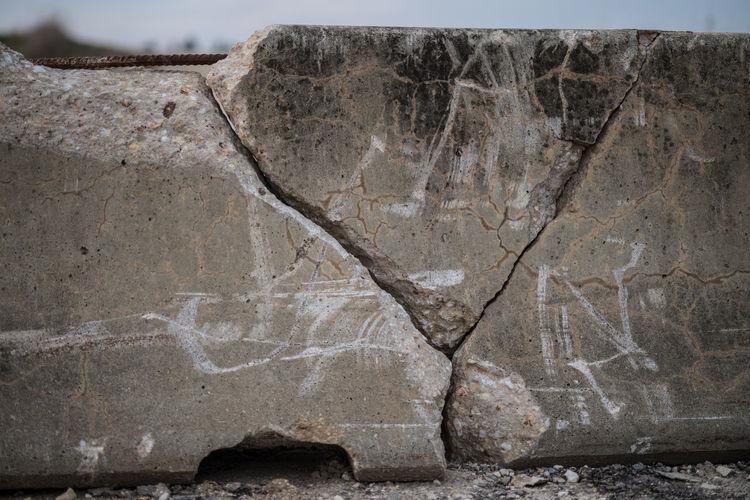 Close-up of cracked concrete barricade