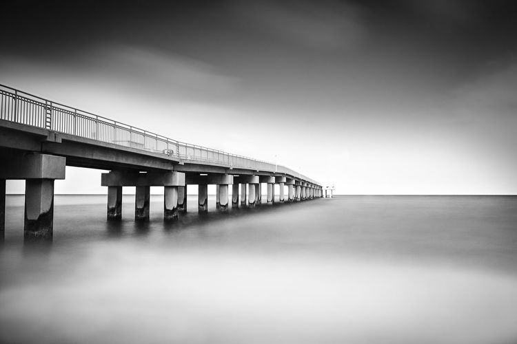 Long Exposure Shot Pier Seascape Photography Architectural Column Architecture Blackandwhite Bnw_captures Bnw_collection Bnw_life Bnwphotography Bridge Cloud - Sky Connection Light And Shadow Long Long Exposure Low Angle View Nature Outdoors Pier Sea Seascape Sky Water