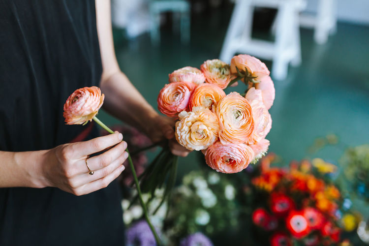 Hands of young florist holding a flower bouquet Decor Entrepreneur Flower Arrangement Plant Ranunculus Asiaticus Woman Arrangement Bouquet Caucasian Colorful Decoration Female Flora Floral Florist Flower Flower Shop Flowers Hand Holding One Person Owner Real People Shop
