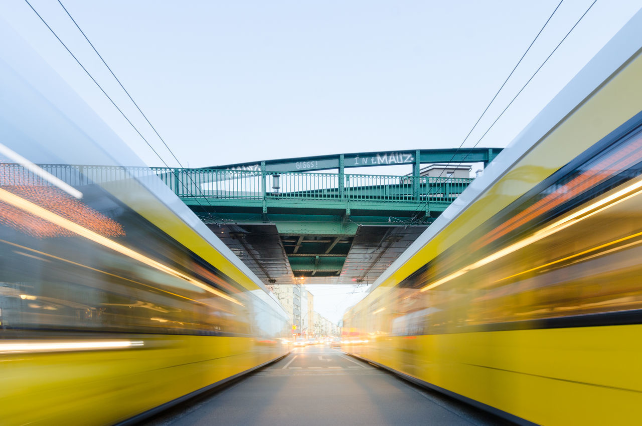 Blurred Motion Of Yellow Trains At Railroad Station