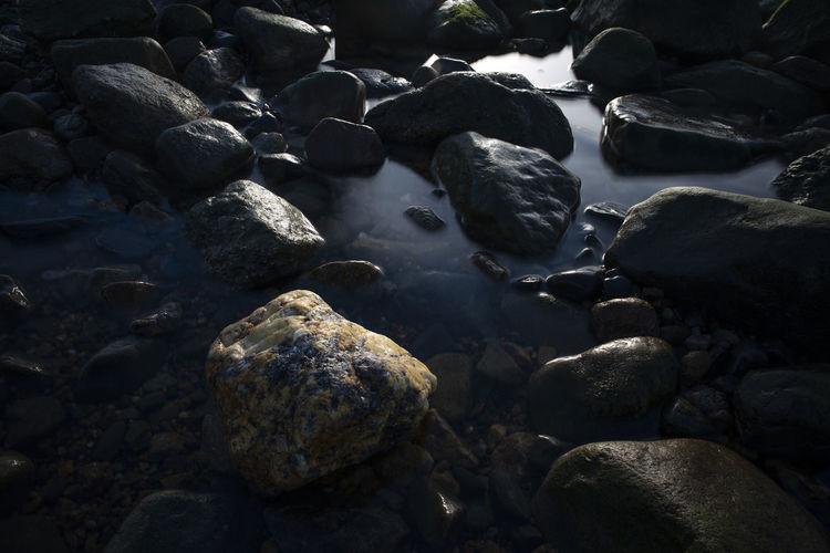 Close-up of stones on beach