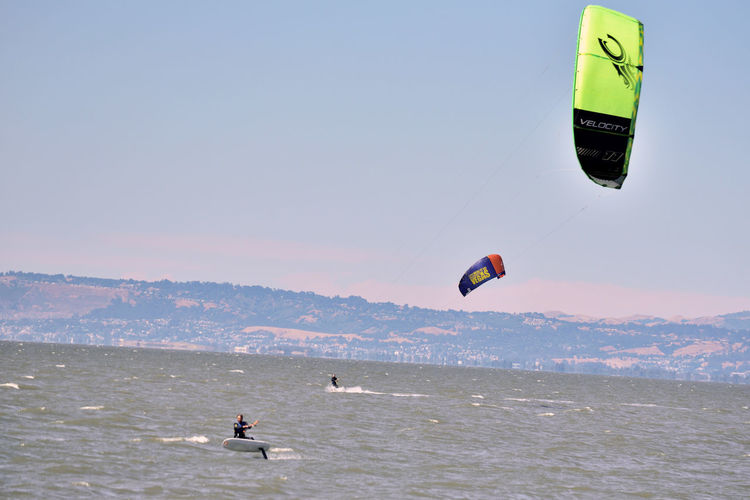 Kiteboarding In San Mateo 3 Kite Surfing Watersports Aquatic Sports Kiteboarding Sport Kite Surfers Wind Power Sail Power Colorful Sails Enjoying Life