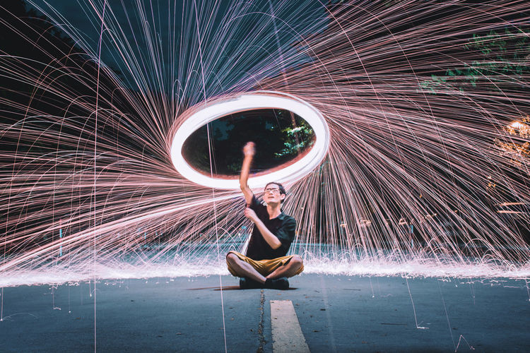 Full length of woman with light painting
