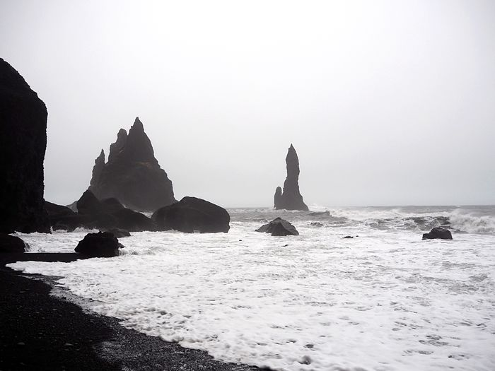 Iceland Volcanic  Stone Idyllic Volcanic Landscape Black Sand Beach Water Sea Sky Rock Beach Rock - Object Nature Land Solid Beauty In Nature Scenics - Nature Tranquility Day Rock Formation Tranquil Scene Clear Sky No People Outdoors Non-urban Scene