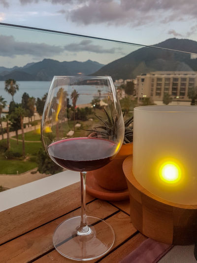 Red Wine Sea View Sea Seascape Panorama Deniz Turkey Panoramic Photography Sea And Sky Mountain Panorama Restaurant Glass Wineglass Water Mountain Alcohol Drink Wine Drinking Glass Table Cocktail Sky Sunset
