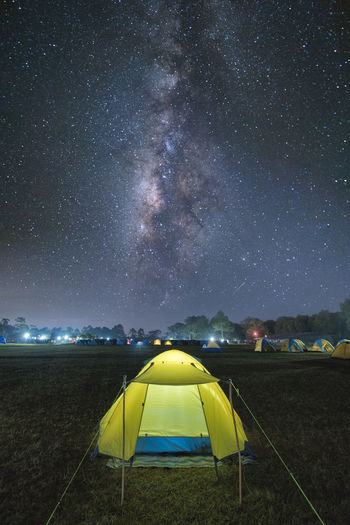 Tent On Field Against Star Field