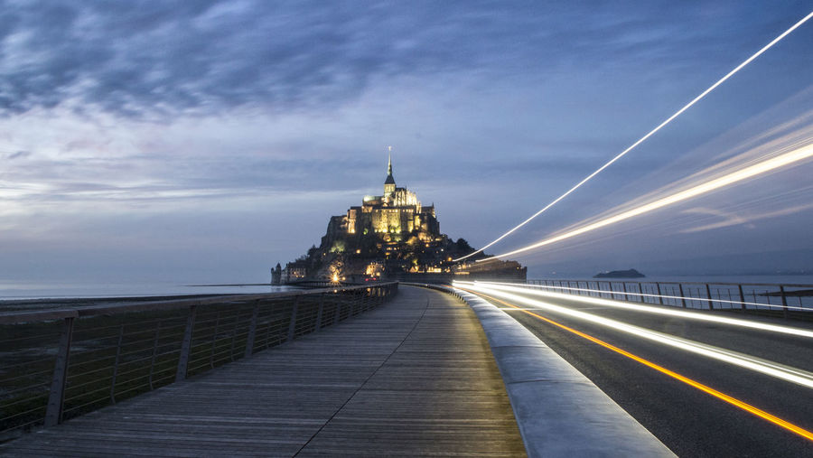 Night Sky Long Exposure Architecture Light Trail Travel Bridge - Man Made Structure Illuminated Travel Destinations Outdoors Transportation Business Finance And Industry Built Structure No People Building Exterior Nature City Mont Saint-Michel Tranquility Cloud - Sky Fog Beauty In Nature Rural Scene Livestock Fragility