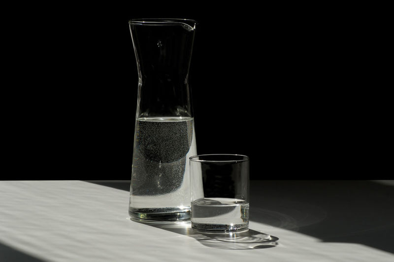 Water in glass on table at darkroom