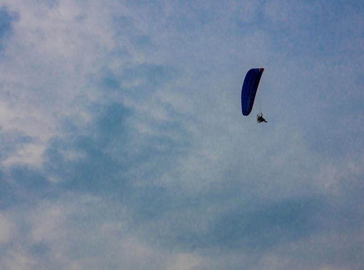 You may want to live in the sky like a bird. Asian  Thailand Sky Blue And Clouds Holiday Flying Mid-air Leisure Activity Paragliding Nature Multi Colored Sky One Person People Sport Extreme Sports Outdoors Day