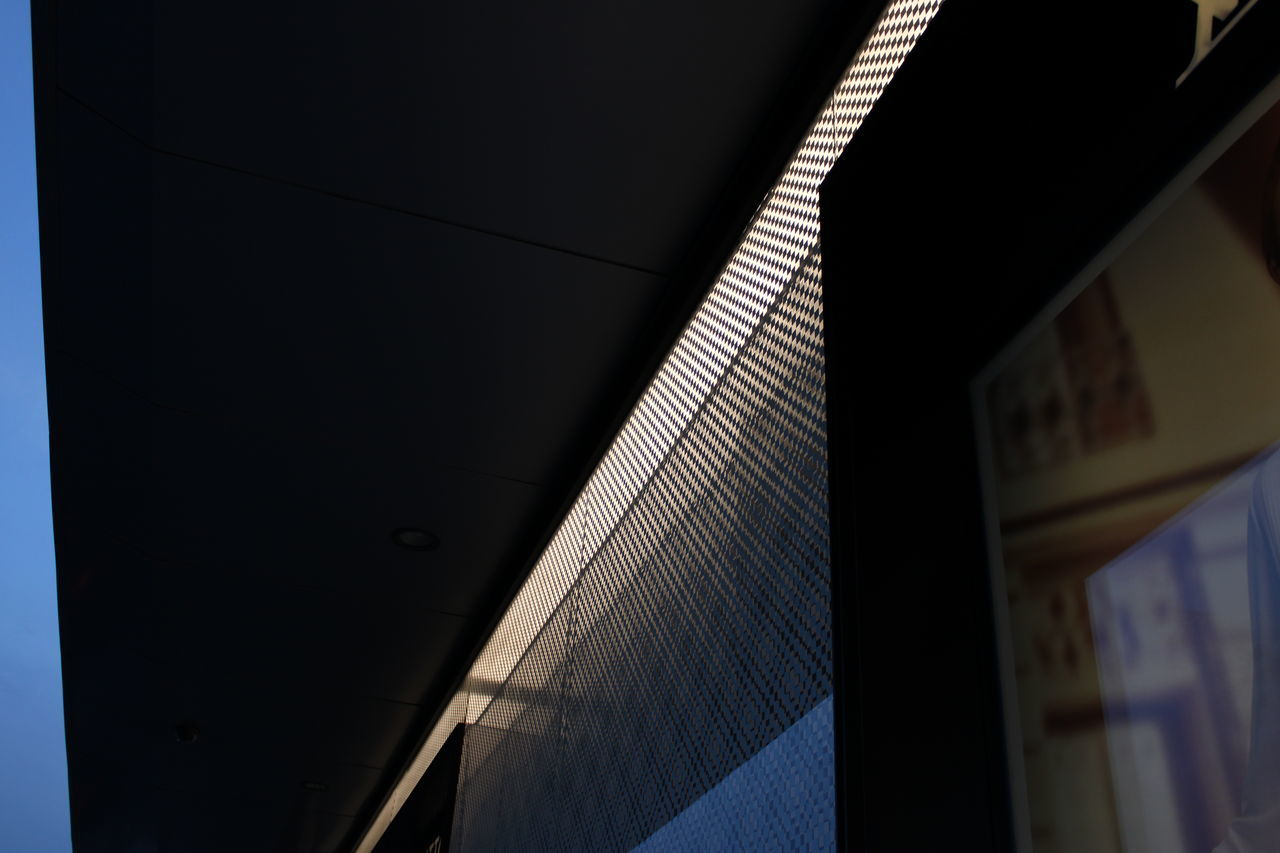 LOW ANGLE VIEW OF ILLUMINATED MODERN BUILDING
