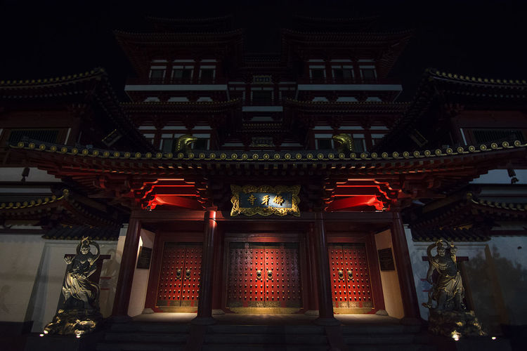 The Buddha Tooth Relic Temple of Chine town, Singapore at night. China Town Singapore Architecture Belief Building Building Exterior Built Structure Chinese Lantern Entrance Illuminated Lantern Lighting Equipment Low Angle View Night No People Ornate Outdoors Place Of Worship Red Religion Spirituality Temple