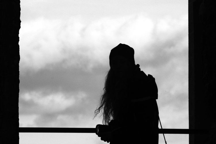 Silhouette woman looking at view