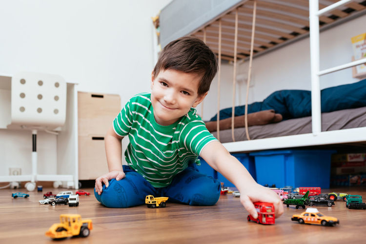 Portrait of boy playing with toy at home