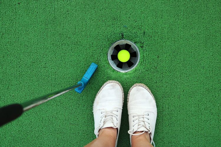 Human Body Part Golf Golf Course Golf Ball Standing Green Color Sport Close-up Personal Perspective