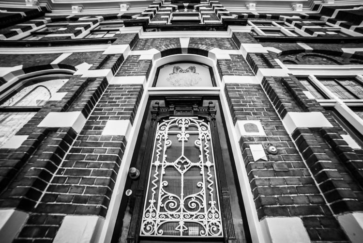 Facade (wideangle) Building Exterior Built Structure Architecture Building Low Angle View No People City Day Outdoors Full Frame Pattern In A Row Window Creativity Residential District Belief Backgrounds Reflection Arch Religion Office Building Exterior