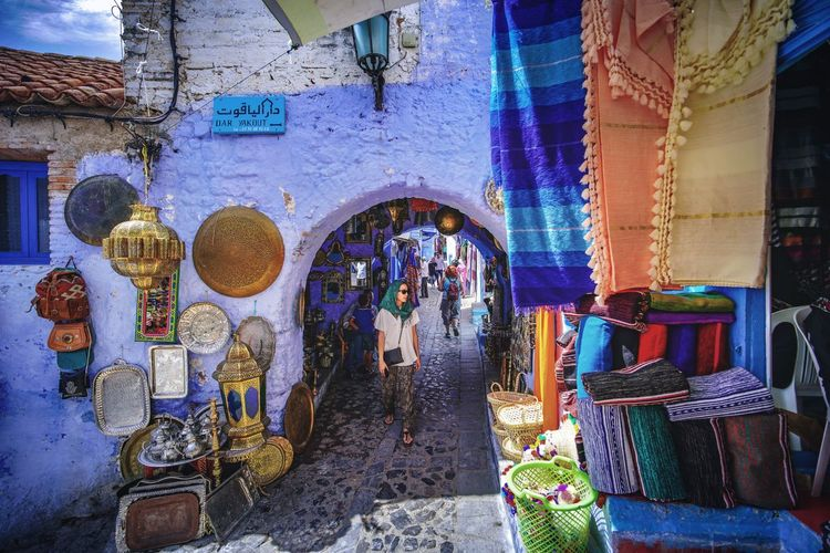 """""""The Blue City"""" - Chefchaouen, Morocco. Chefchaouen Chefchaouen Medina Chefchaouen Blue City MoroccoTrip Morocco Travel Digital Nomad EyeEmNewHere Travelling Tourist Attraction  Tourism Architecture Building Exterior Built Structure Real People Market Stall Women Market Men Adult Group Of People Retail  Small Business Arch Shopping Business Day Store For Sale People Selling Outdoors Retail Display Street Market Sale"""