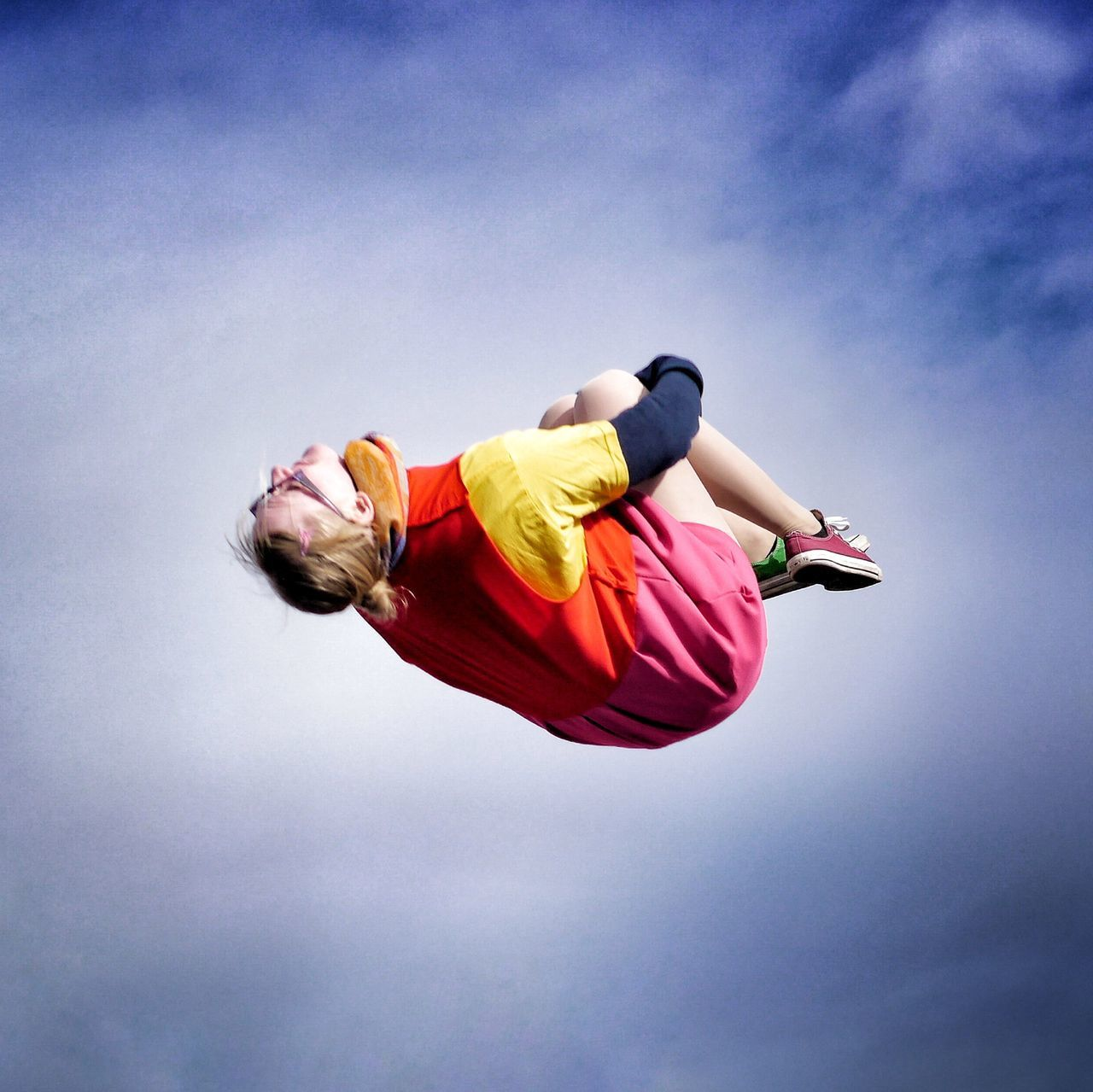 mid-air, low angle view, sky, one person, full length, flying, outdoors, motion, blue, day, jumping, childhood, energetic, young adult, people