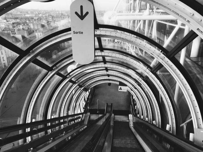 Arrow Sign At Empty Moving Walkway