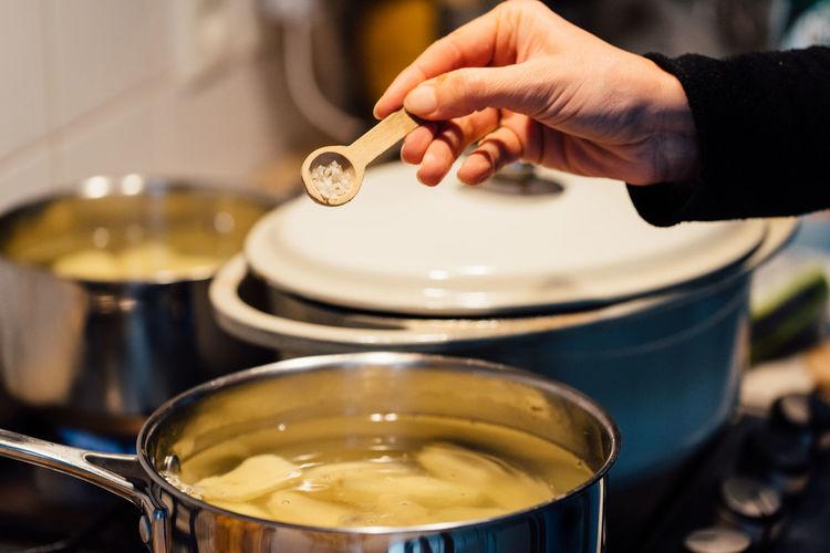 Cooking Kitchen kitchen utensils Cooking Pan Spoon Wooden Spoon Salt Salt - Mineral Human Hand Preparation  Close-up Saucer Prepared Food Served Cooking Pan Saucepan Burner - Stove Top Frying Pan Gas Stove Burner Cooking Utensil Skillet- Cooking Pan Pan Cast Iron