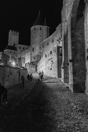 Carcassone, France Carcassonne Carcassonne City MedievalTown Night Photography Architecture Black And White Building Exterior Built Structure Castle History Leisure Activity Lifestyles Medieval Architecture Men Monochrome Night Outdoors People Real People Tourism Travel Travel Destinations Walking Women