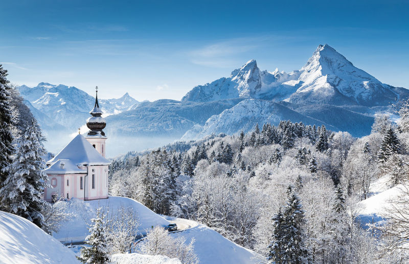 Maria gern church on snowcapped mountains against sky