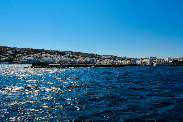 Harbor Mykonos,Greece Architecture Blue Blue Water Blue Water Blue Sky Building Exterior Built Structure Clear Sky Go-west-photography.com Greece Harbor View Harbor Wall Kyklades Kyklades Islands Mykonos Nature No People Outdoors Rock - Object Sea Sky Travel Destinations Water White Houses