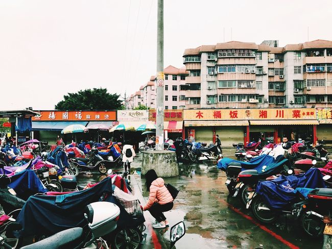 Rain in Guangzhou Architecture Motorcycle Real People City China View Building Exterior Transportation Outdoors