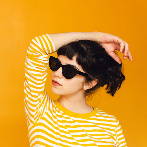 Victoria. Colored Background Fashion Glasses Headshot Indoors  Lifestyles One Person Portrait Studio Shot Sunglasses Yellow Young Adult