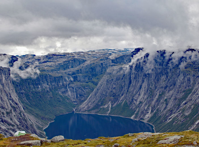 View along Trolltunga hike Norway Beauty In Nature Cloud - Sky Day Environment Landscape Mountain Mountain Peak Mountain Range Nature No People Non-urban Scene Outdoors Remote Rock Scenics - Nature Sky Snowcapped Mountain Storm Tranquil Scene Tranquility Travel Destinations Trolltunga Norway Hiking