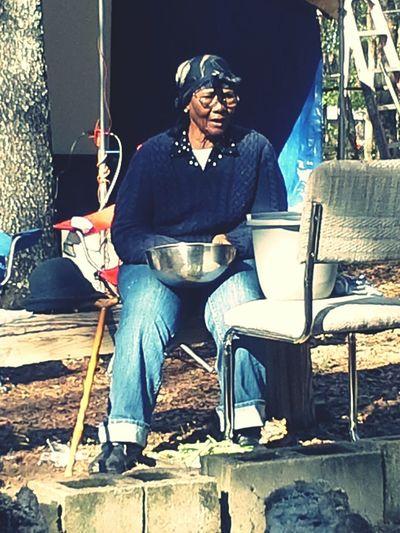 Grandma shelling peas