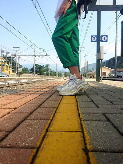 Verona Veneto Italy Stazione Domegliara Yellow Green One Person Sky Transportation Day Nature Body Part City Lifestyles Low Section Human Leg Walking Real People Road Human Body Part Mode Of Transportation Street Sunlight Leisure Activity Casual Clothing Outdoors The Traveler - 2018 EyeEm Awards