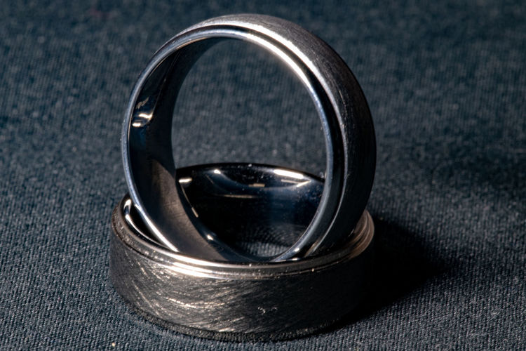 Ring Jewelry Close-up Metal Wedding Single Object Life Events Wedding Ring Indoors  Event Celebration Focus On Foreground Studio Shot Silver Colored Engagement Ring No People Two Objects Circle Extreme Close-up Geometric Shape Expense Steel Personal Accessory Alloy