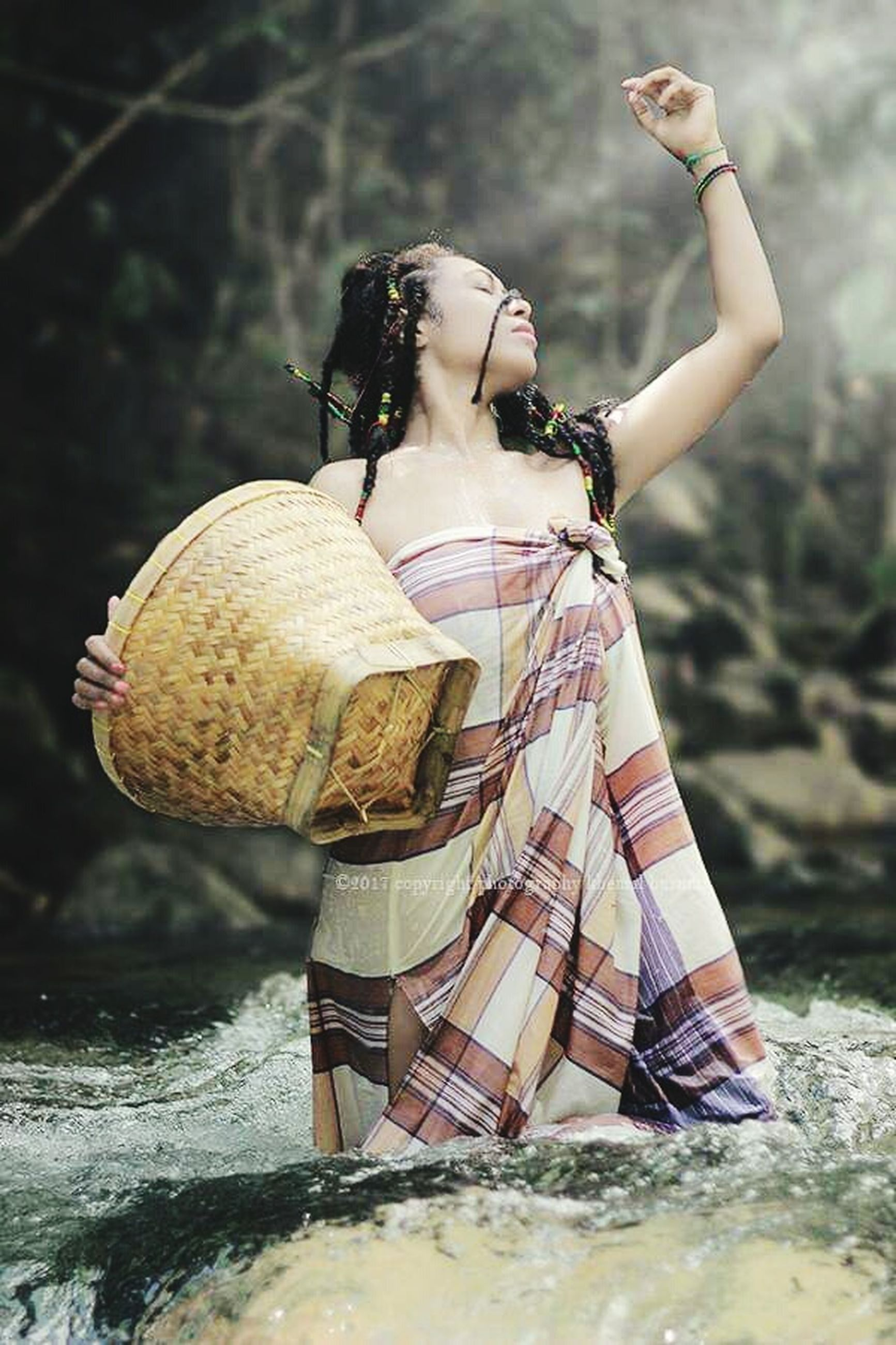 one person, full length, real people, young adult, water, lifestyles, adult, women, day, nature, standing, holding, leisure activity, young women, casual clothing, focus on foreground, happiness, human arm, outdoors, beautiful woman, arms raised, hairstyle