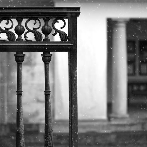 Close-up of wet metal railing during rainy season