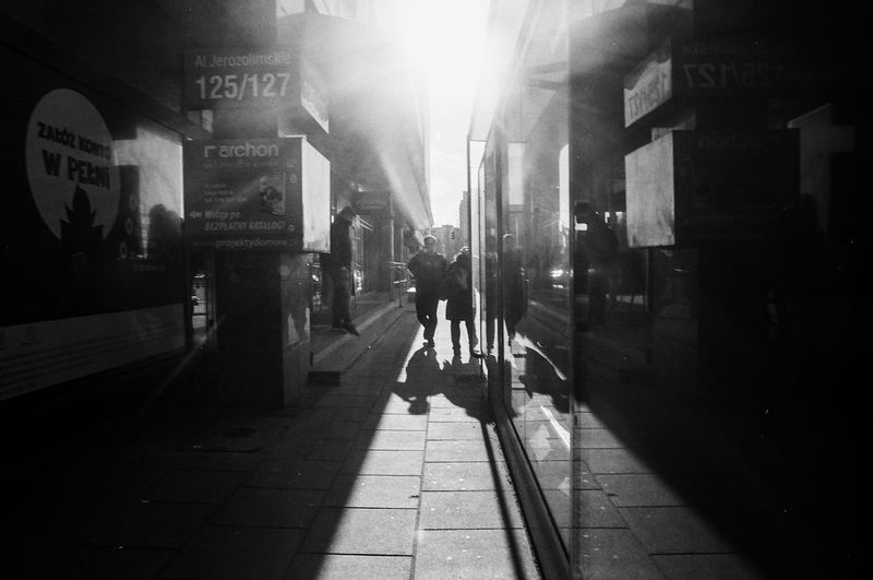 ANALOG Ilford Pan 100 The Week on EyeEm Light And Shadow Analogue Photography Nikonphotography Street Photography Bnw Capture The Moment Film Photography Black And White Architecture Real People Built Structure Walking Sunlight Building Exterior City Men Footpath Direction Lifestyles City Life Shadow People Full Length Rear View The Way Forward Text Nature Outdoors Lens Flare The Art Of Street Photography