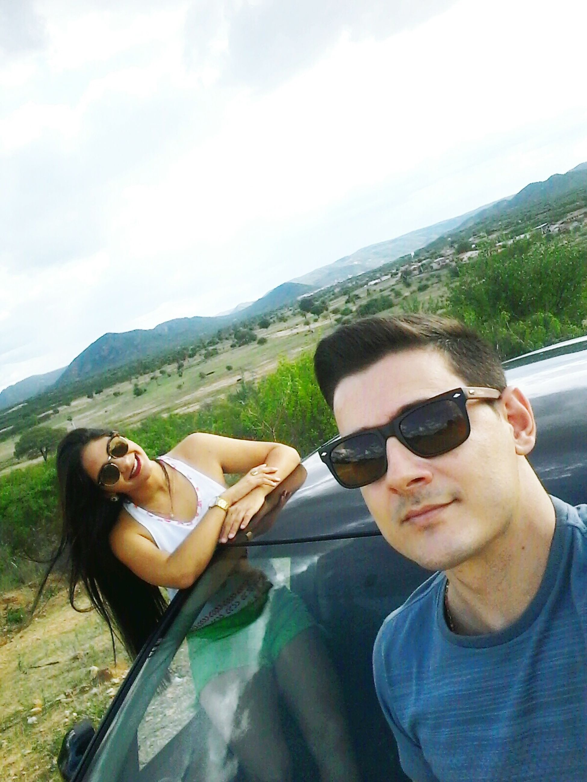 young adult, sunglasses, two people, young women, togetherness, happiness, heterosexual couple, vacations, adults only, smiling, sky, adult, friendship, summer, portrait, women, outdoors, people, bonding, day, beautiful woman, men, nature, beauty in nature, mountain