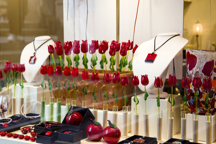 A storefront with red glass tulips on it. Shopping Tulips Abundance Arrangement Choice Close-up Counter Day Food Food And Drink For Sale Freshness Glass Indoors  Large Group Of Objects Multi Colored No People Purchase Purchases Red Retail  Shopping Time Showcase Trade Variation