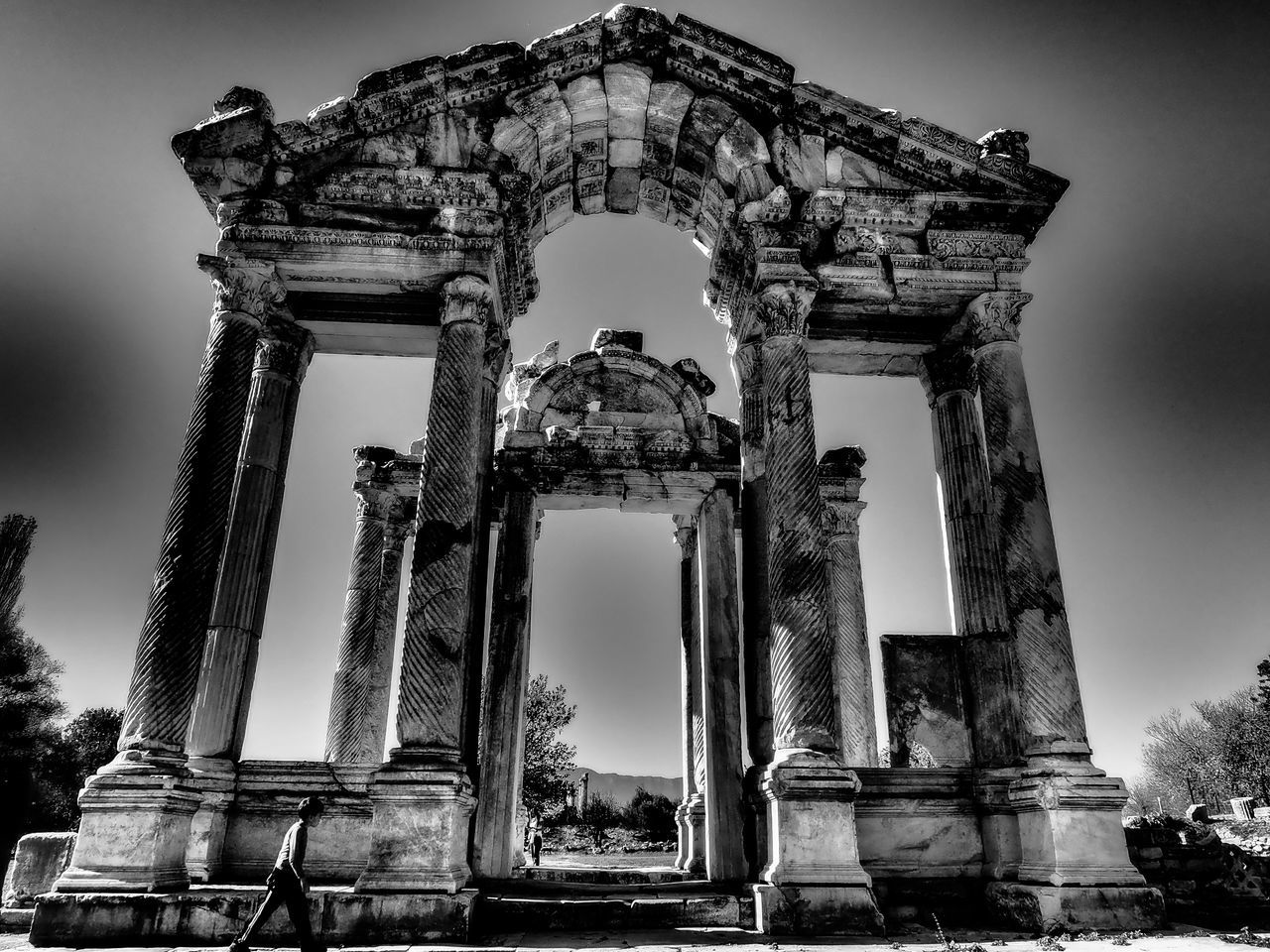 history, ancient, old ruin, the past, architectural column, architecture, built structure, ancient civilization, sky, low angle view, travel destinations, tourism, archaeology, weathered, damaged, bad condition, outdoors, travel, abandoned, no people, spirituality, building exterior, day