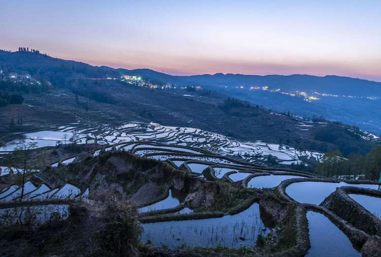 High angle view of snow covered landscape during sunset