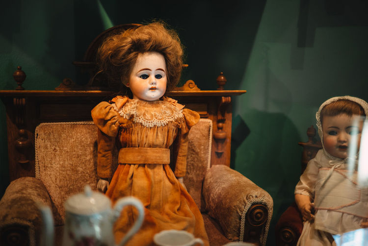 Doll On Armchair At Home