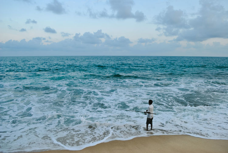 I want to go there again. Beautiful views! Beach Beauty In Nature Cloud - Sky Fish Fishing Horizon Over Water Nature One Person People Rear View Sea Sky Water Clouds Tranquility Traveling ASIA