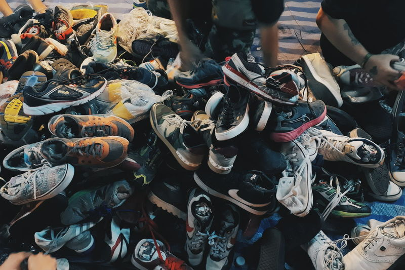 High Angle View Of Shoes At Market