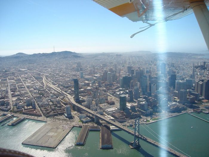 Cropped image of airplane flying over san francisco-oakland bay bridge
