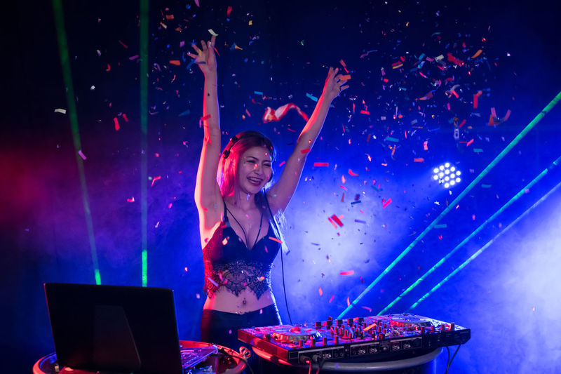 Music Arts Culture And Entertainment Nightlife Enjoyment Event Night Technology Laptop One Person Performance Young Adult Happiness Nightclub Indoors  Illuminated Emotion Wireless Technology Real People Arms Raised Using Laptop Human Arm Club Dj Positive Emotion Excitement Skill