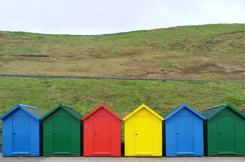 Multi Colored Green Beach Against Blue Sky