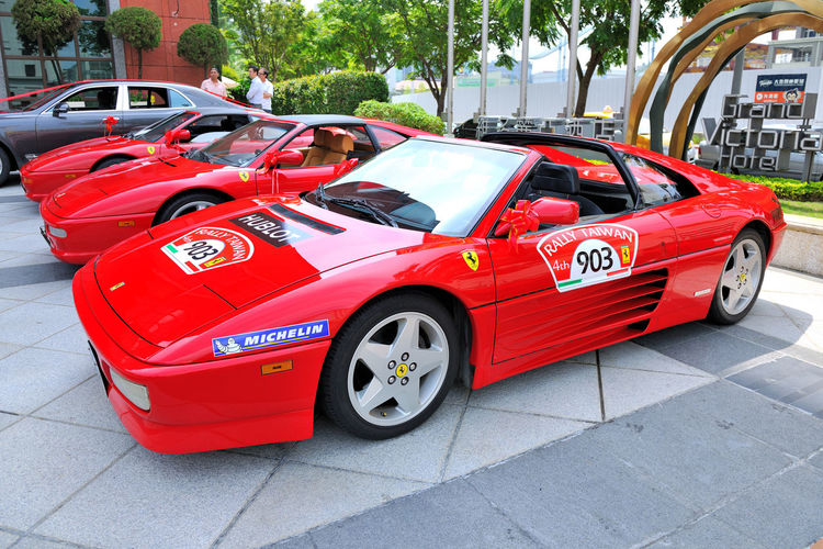 Expensive sports car Ferrari Advanced Bright Ferrari Car Day Expensive Famous Place Identity Land Vehicle No People Noble Outdoors Parking Red Red Car Sports Car Sports Race Transportation