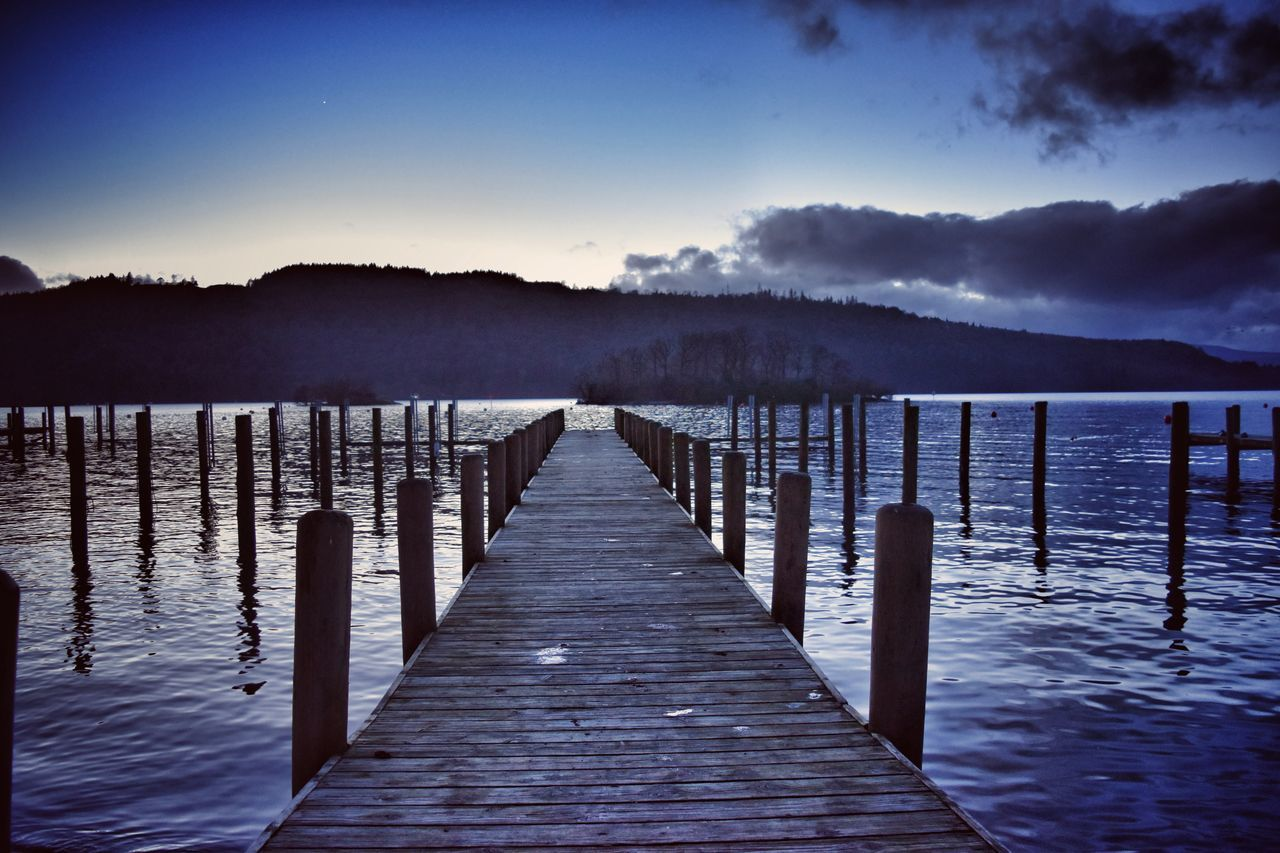 pier, water, lake, wood - material, jetty, wooden post, tranquility, nature, tranquil scene, outdoors, no people, sky, beauty in nature, scenics, sunset, wood paneling, day